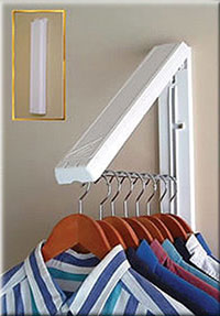 Laundry room accessory - wall-mounted bar to hold hanging items. This is a clever DIY addition to a great laundry room.
