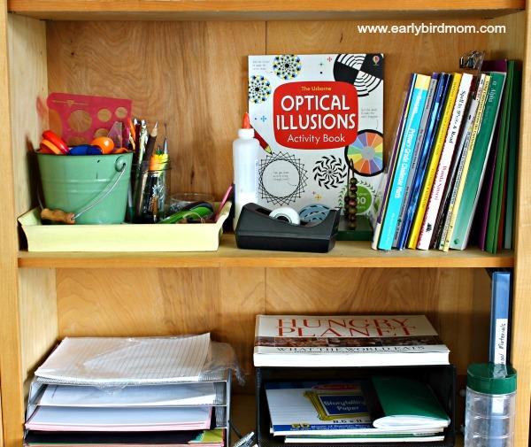 Homeschool bookshelves with office supplies