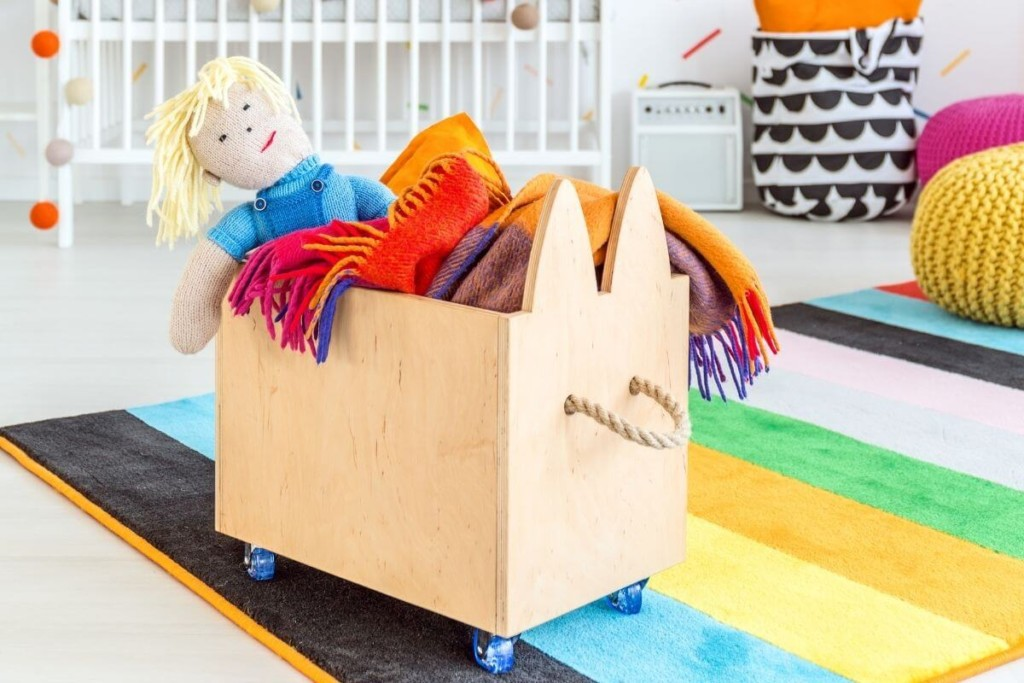 toy box on wheels keeping living room tidy