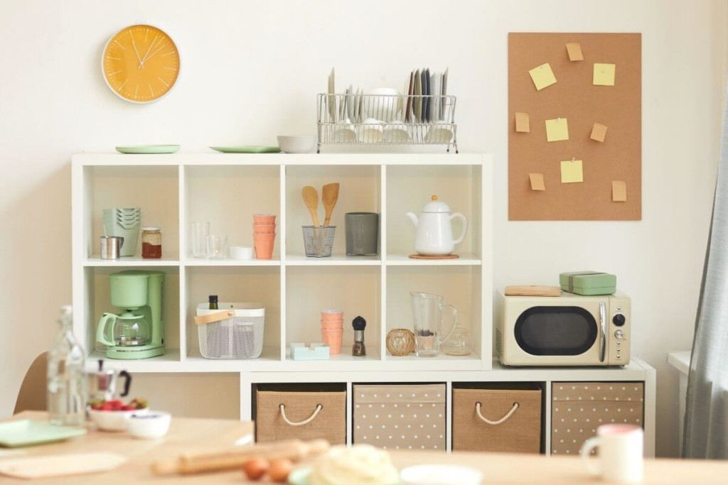 Bring in a bookshelf to create a makeshift pantry space.